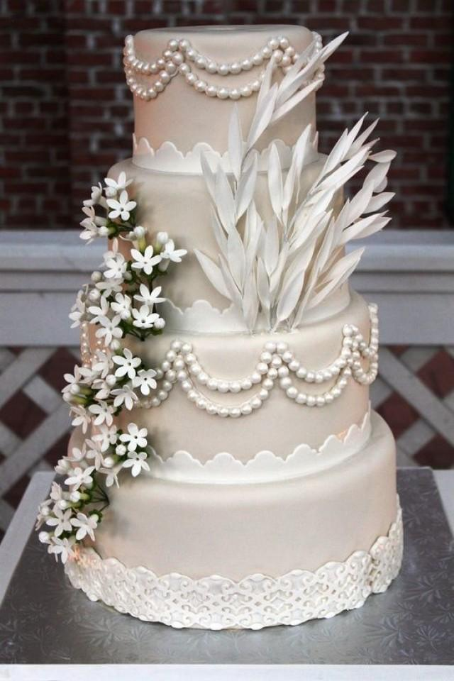 Four Tier Satin Wedding Cake Decorated In Style 2038675