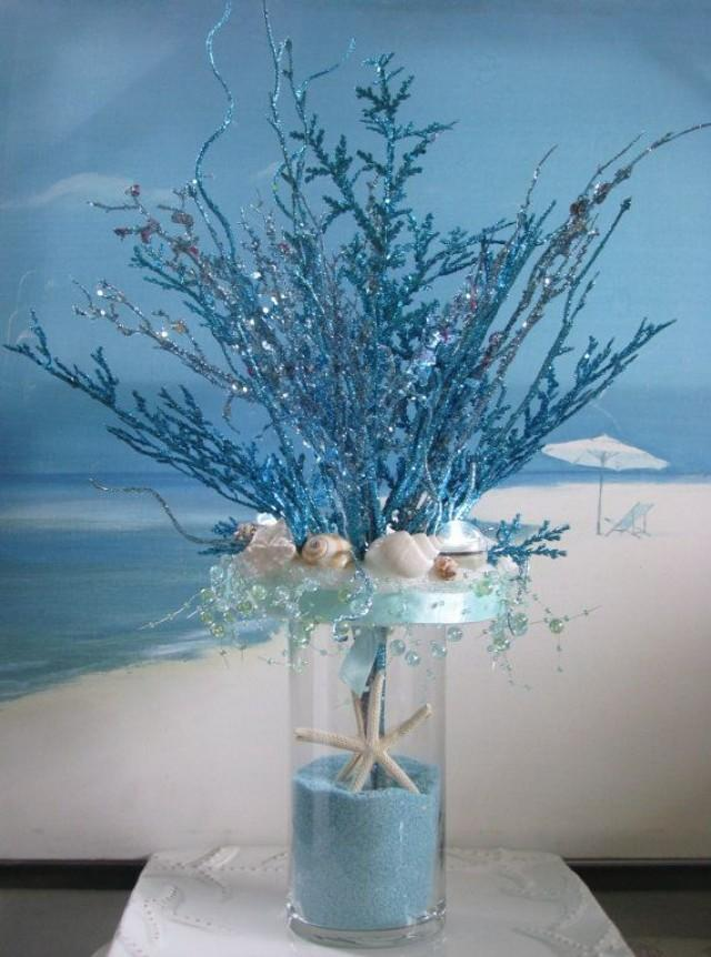 Blue coral seashell sand wedding centerpiece beach