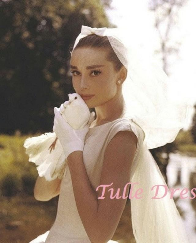 Audrey Hepburn In Wedding Dress With Veil Holding A Dove In Color