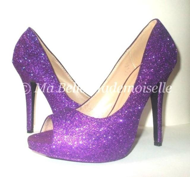 Low Heel Purple Glitter Shoes. If your have plans for a club night, you may want to get a pair of fabulouslow heel purple glitter shoes. If you are a fan of the disco era and this blends well with your outfit then these are a must have.