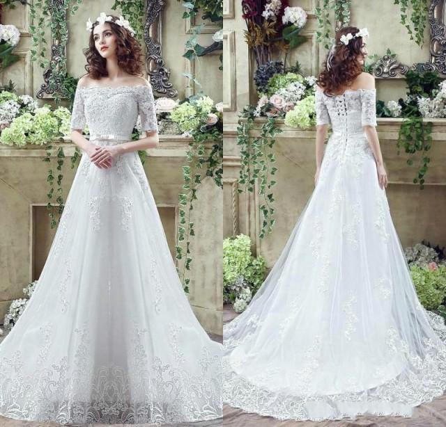 Vintage illusion off shoulder wedding dress half sleeve for Wedding dresses off shoulder sleeves