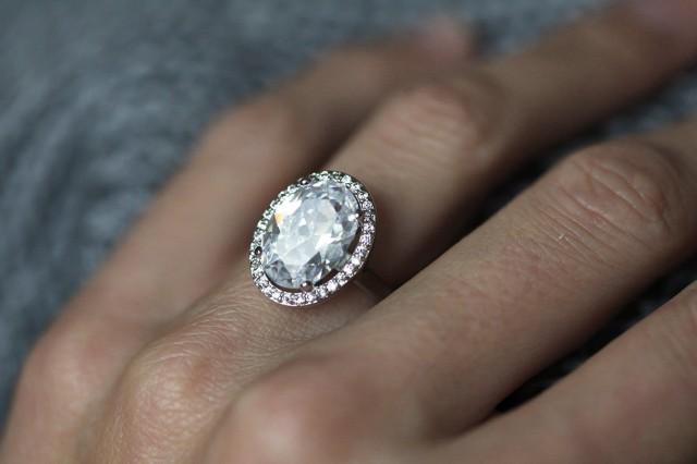 Large Gold Oval Fb Moissanite And Diamonds Halo Engagement
