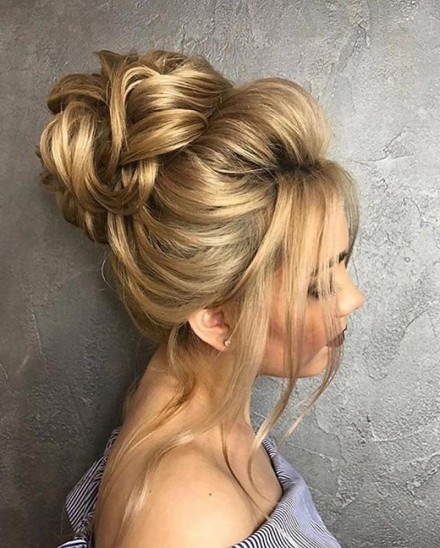 Причёски с пучком на длинные волосы 16