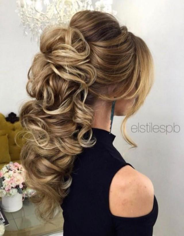 Braided Loose Curls Low Updo Wedding Hairstyle 2668480